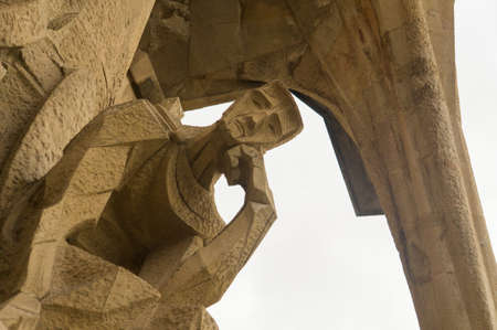 church architecture: Pontius Pilato in the sculpture of Ecce Homo in the Passion Facade of the Sagrada Família, Barcelona, Spain.