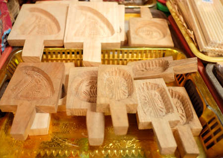 mould: Basket contain varient of wooden biscuit mould.