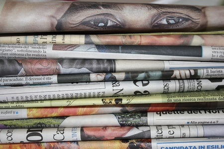 pile of newspapers with eyes that look