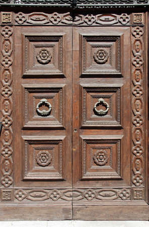 Ancient Italian wooden door from Perugia, Umbria photo