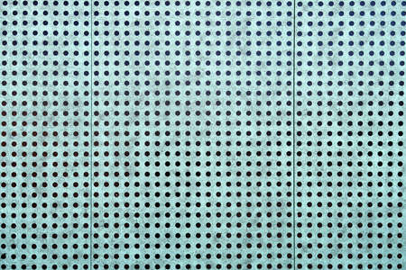 Light blue wall with black dots, close up photo