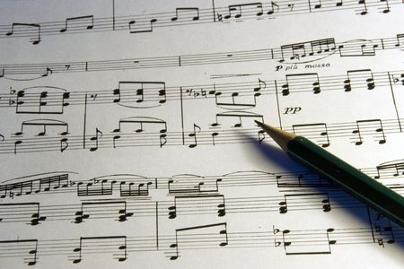 Dark - green pencil on musical notes sheet Stock Photo - 3904542