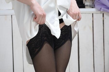 sexual intimacy: black stockings Stock Photo