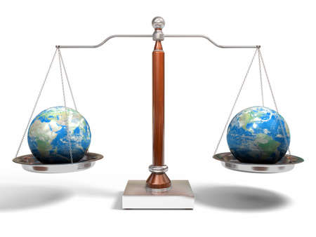 Globes on balance scale Stock Photo