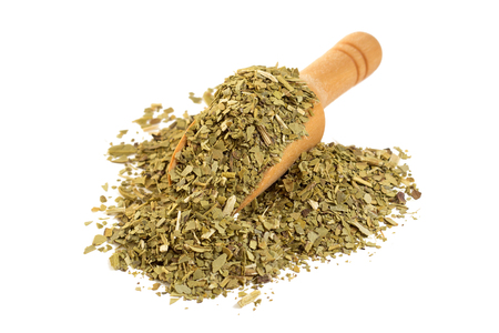 Yerba mate with a wooden spoon on isolate a white background 写真素材