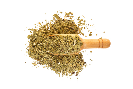 Yerba mate with a wooden spoon on isolate a white background Stock Photo