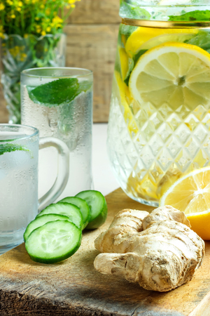 staying fit: Water with lemon, ginger, cucumber, mint Stock Photo