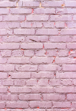 Background of a wall from a pink brick Stock Photo