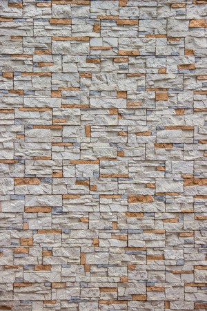 Orange and gray stone in masonry