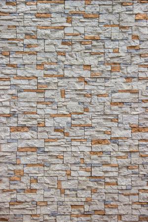 Orange and gray stone in masonry