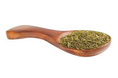 finocchio: Dried fennel in a wooden spoon on a white background Archivio Fotografico
