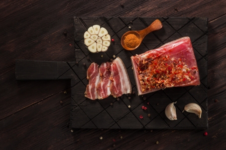 Salted dried bacon with spices and bay leaves and garlic 写真素材