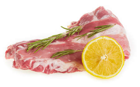 Raw pork ribs with rosemary and lemon on a white background isolate