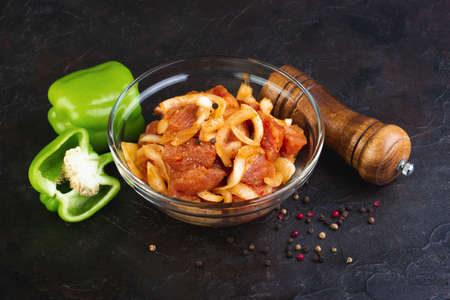 Pork marinated with onion, spices and Bell pepper Stockfoto