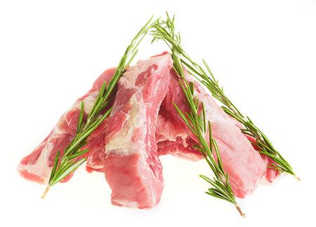 Sliced pork ribs with rosemary on a white plate, isolate Zdjęcie Seryjne