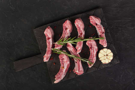 Raw chopped pork ribs with rosemary and garlic