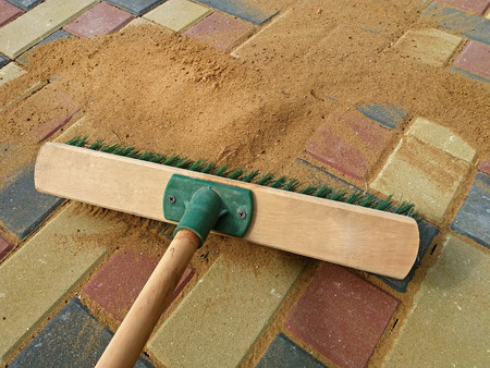 Filling paving joints, Brushing dry sand. Finishing work