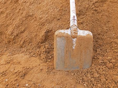 A shovel in construction sand with copy space Reklamní fotografie