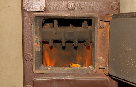 The fire burns in the stove winter home heating concept Banque d'images - 138071689