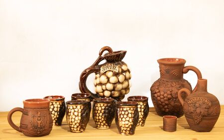 Souvenir from Moldova - Ceramic jugs and cups. On white background.