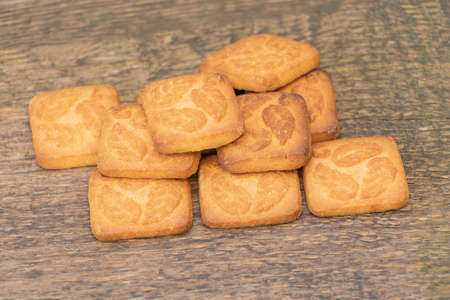 Delicious and sweet biscuits on a wooden background. match with a tea coffee. Reklamní fotografie