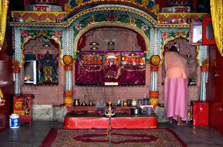shakti: Priest preparing for Morning Puja at the Manibandh Shaktipeeth in Pushkar, Rajasthan, India
