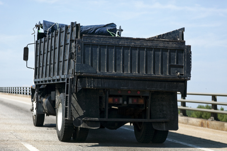 Rear View of Heavy Duty Construction Truck on Highway