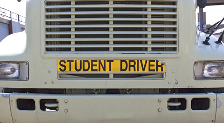 STUDENT DRIVER sign on front of semi truck. Horizontal.
