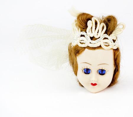 Wide awake sleeping doll head princess. Banco de Imagens