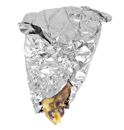 Leftover slice of pizza wrapped in tin foil with tip of pizza showing. Isolated.