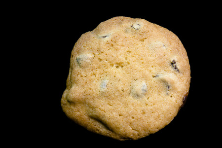 Homemade chocolate chip cookie on black background. Banco de Imagens