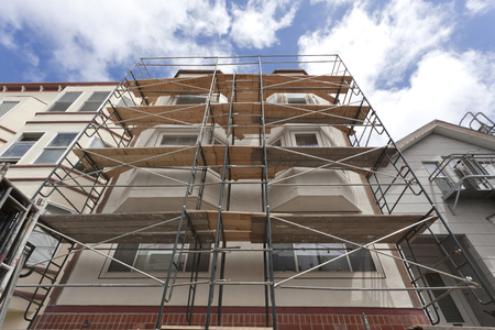 Looking up at building renovation scaffolding. Horizontal.