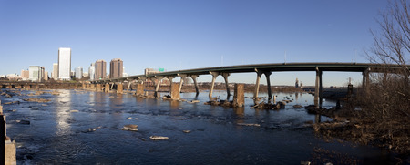 Richmond, Virginia cityscape along the James River.