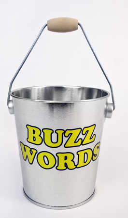 BUZZ WORDS concept with shiny silver bucket. Isolated. Banco de Imagens - 80611387