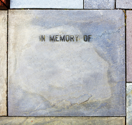 Blank IN MEMORY OF stone with copy space. Imagens