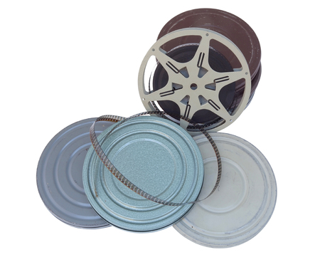 Vintage 1940s home movie canisters and film reel. Isolated.