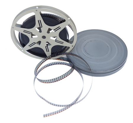 Vintage 1940s home movie canister and film reel. Isolated.