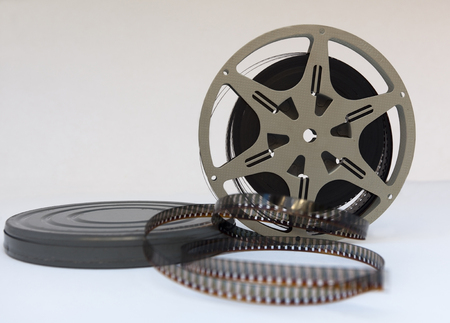 Vintage 1940s home movie canister and film reel.