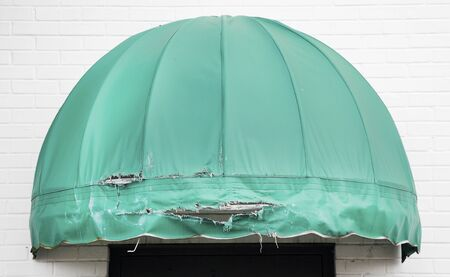 Weathered green building awning canopy needs replacement. Stock fotó