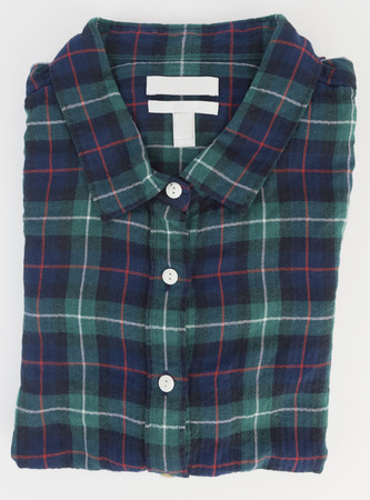 Green and blue folded plaid mens long sleeve cotton short. Isolated.