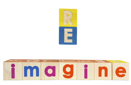 RE IMAGINE concept spelled out with toy blocks. Isolated. Stock Photo