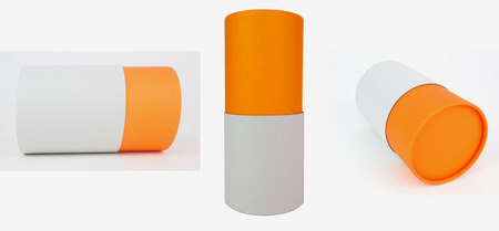 Orange and white packaging cylinders. Stock Photo