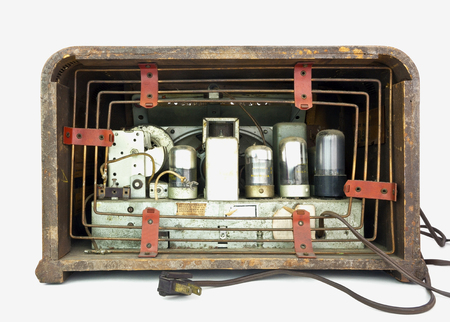 collectible: Rear view of antique vacuum tube radio in wood case. Isolated. Stock Photo