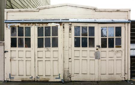 Old, weathered, vintage garage doors.