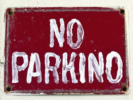 Homemade NO PARKING (PARKINO) sign. No Parking misspelling sign. Isolated.