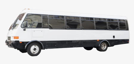 Isolated white charter tour bus.