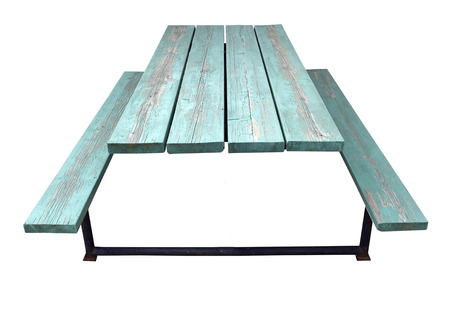 deign: Bluish-green weathered picnic table. isolated. Stock Photo