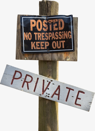 POSTED NO TRESPASSING KEEP OUT PRIVATE sign on wood pole. Isolated.