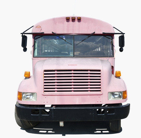 Isolated front view of old faded school bus painted pink.