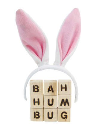 Pink Easter bunny ears with BAH HUMBUG message. Fun. Humor. Isolated.